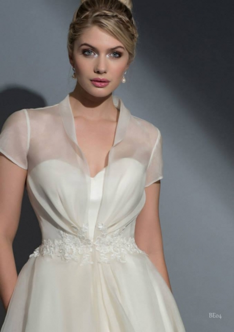 Ottiline with coat by Louise Bentley from Lori G Bridal Shop Derby