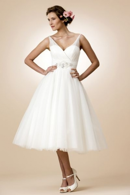 W112 by True Bride is a soft, tulle wedding dress. from Lori G Derby